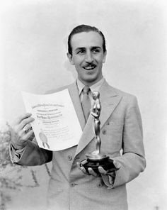 Walt Disney poses with his first oscar, mid 30's, I.V.