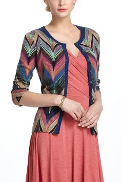 I'm not into the chevron craze *at all* but this cardi is beautiful! probably due to the lovely curvature of the chevrons...reminds me more of a stylized peacock pattern. Seared Chevrons Cardigan - Anthropologie.com
