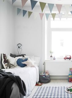 A light and bright kids room with pops of muted colours