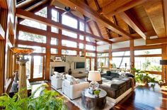 Low Country coastal contemporary timber home with view of ocean - Living Room