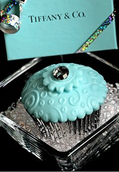 We've seen petite fours and cakes, but cupcakes made in high fashion with candied diamond accents? Amazing.  We think they are fantastic additions to a bridal or baby shower menu and perfect for a birthday celebration.  What do you think?