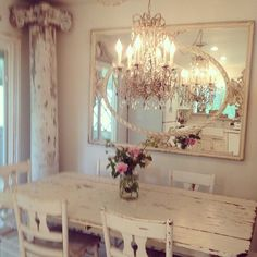 Rustic and romantic dining space. Great architectural elements alongside elegant chandelier and mirror.