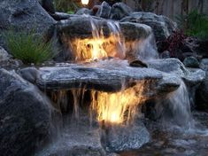 underwater lighting in a waterfall, lighting, outdoor living, ponds water features, Double the impact or your water feature by adding lights for an after dark experience