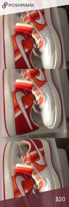 Nike Tennis Shoe White sneaker, white Nike check, Orange and red detail on the side and orange around lace area.  Laces are white. Strap is orange red and white. Bottom sole is red. Shoes are in used but good condition. Nike Shoes Athletic Shoes