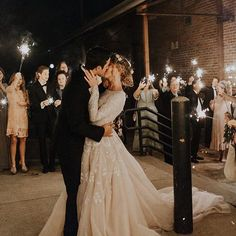 Wedding photo bride and groom sparklers family friends magical wedding dress married kiss love