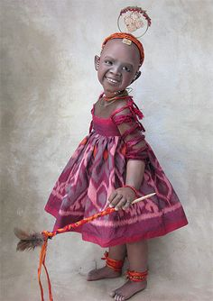 "Samburu Child is part of the Samburu tribe in the foothills of Mount Kenya. 25"" tall. She has a cloth body with porcelain shoulders and limbs. A 2010 one-of-a-kind edition by Susan Krey."