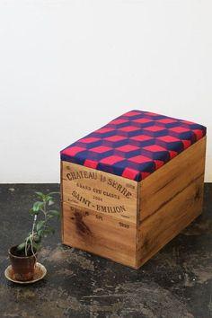 Repurpose a wine crate into a storage ottoman.