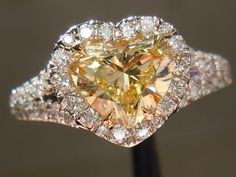 Halo Diamond Ring: 1.01ct Heart Shape Fancy Light Yellow SI1 GIA Platinum and 18K by Diamonds by Lauren