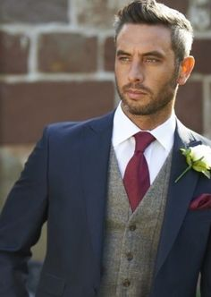 Groom and groomsman suits in navy and maroon