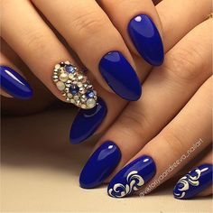 Glossy Studded Blue and White Nail Art Design. this glossy dark blue and white nail art design is definitely the one worth trying. The rhinestones adds the best to this nail art.