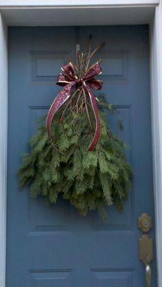 Homemade door decor! Pine boughs courtesy of a neighbor who trimmed the bottom of their tree and a handmade bow courtesy of my crafty friend!