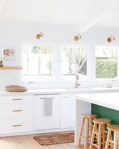 Kitchen with pop of green on the island