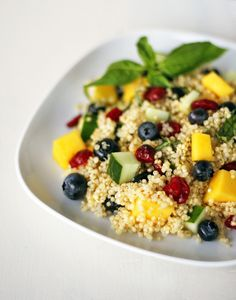 Mango Blueberry Quinoa Salad    1/2 cup quinoa (washed)  1 cup water    1 mango cut into cubes  1/2 cup blueberries  1 medium cucumber cut into cubes  1/4 cup dried cranberries    1 1/2 tablespoons extra virgin olive oil  Juice from 1 lemon  1 teaspoon orange marmalade  10 Basil leaves chopped finely  Salt and pepper to taste