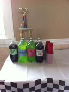 Gage's Hot Wheels Party - labeled drinks, also used my husbands old racing trophies as some of the decor.