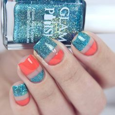 A fun looking stripes glitter nail art design in blue glitter and melon nail polish on top of a clear base coat.