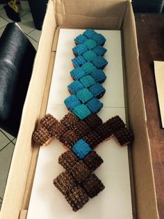 I saw that going differently in my mind...: Minecraft sword cupcake-cake