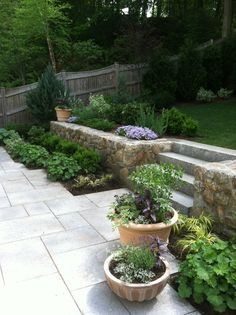 Carey Ezell Landscape Design. Terra cotta containers on a granite terrace.
