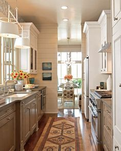 Traditional Home kitchen. White top cabinets , color on bottom. Shiplap walls for added texture