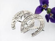 vintage brooch that is packed with lucky symbols for a happy marriage - double horseshoe, butterfly, ivy, flowers, and swallow sterling silver brooch. Victorian Wedding Brooch  1888 Twin Horseshoes Butterfly &