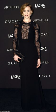 Lovely in lace: Evan Rachel Wood donned a dramatic black gown and a deep burgundy lip at the LACMA Art + Film Gala http://dailym.ai/1DMjl91