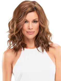 Top Wave 12' by Jon Renau is a wavy styled clip in hair piece / topper. It can be worn at the hairline or slightly behind to integrate with your own hair. The density and layering adds body, length, and fullness to fine or thinning hair.