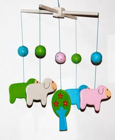 Goldfish Wooden Sheep Mobile is designed in Australia by Goldfish Gifts and lovingly handmade in a small family workshop in Bali. All the paints used are non toxic and the mobiles are totally made by hand. The wood used is either mdf or pine from controlled plantation forests. This mobile comes in a tulle bag from another small village on the other side of Bali where previously unemployed stay at home mothers gather to gossip and work together..and lots of smiling too! Sheep Mobile, Man Shed, Child Smile, Make Happy, Wooden Gifts, Goldfish, Forests, Sheds, Mobiles