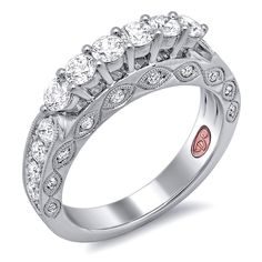 great sub for engagement/wedding band Designer Engagement Rings from DemarcoJewelry.com Available in White or Yellow Gold 18KT and Platinum. 1.111 RD Capture her grace and endless beauty with this confident yet elegant design. We have also incorporated a unique pink diamond with every single one of our rings, symbolizing that hidden, unspoken emotion and feeling one carries in their heart about their significant other.