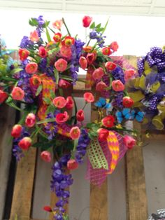 colorful wreath on grapevine by Kathy at the Augusta GA Floral Dept