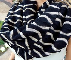 Black and Ivory Metallic Wave Infinity Scarf. The perfect Fall and Winter scarf. Makes a great Christmas gift! This uber comfy scarf is made with a top quality black knit fabric that features a metallic cream wave design for the just the right amount of drama. It's sure to match any outfit! You can wear the infinity scarf long and casual or double twist it for a chunky look. These soft and luxurious scarfs are the perfect accessory to keep you warm on those brisk Fall and Winter days. The...