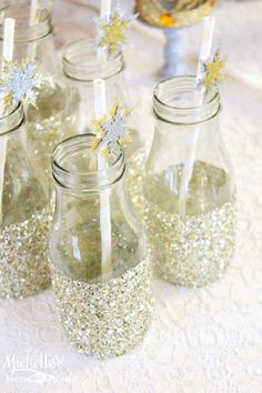 Gold + Silver Christmas Dessert Table via Kara's Party Ideas : Glitter bottles