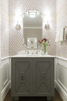 custom vanity, wainscoting, wallpaper, sconces