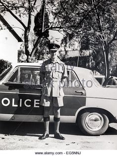 Patrol Officer in the Southern Rhodesian Colonial Police with 'B' Car Austin vehicles, Bulawayo, - Stock Image Army Police, Police Officer, Police Cars, Military Gear, All Nature, Zimbabwe, Old Boys, Africa Travel, Ford Trucks