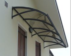 Wrought iron awning with polycarbonate panel