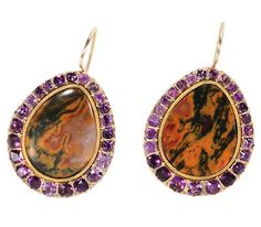 Circa 1810 Each of the earrings features a teardrop shaped agate of pumpkin orange and moss green with maroon hues set closed back. A border of 15k yellow gold frames the agate and separates it from a surround of twenty-four (24) natural amethysts in pinched collets and set closed back.