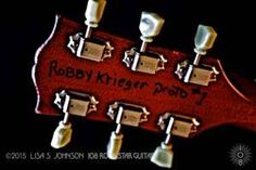 "Here's your latest chance to enter this month's Robby Krieger contest to win a print set of The Doors guitarist's instrument - signed by Robby and Lisa S Johnson! Answer the following question correctly and we'll draw the winner at the end of the month! The Doors were the house band for the famous LA club, Whiskey A-Go-Go, in 1966 but were fired when they performed an explicit version of which song? A.) ""Soul Kitchen"" B.) ""End of the Night"" C.) ""Twentieth Century Fox"" D.) ""Back Door Man"" E.)…"