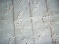 Antique salesman's sample of raised embroidery on organdy