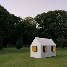 Chameleon Cabin made from paper changes color when viewed from either side.