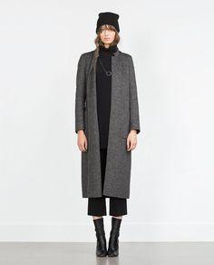 Love the elegant look of this long wool coat! From Zara.