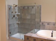 Bathroom. Inspiring Bathroom Remodel Design With Granite Tiles Half Wall Combined The Beige Paint Wall Attached Head Shower In Glass Shower Cubicle Plus Oval Tub With Home Remodeling Ideas And Remodeling. Make Us More Attractive Interior With A Bathroom Remodel Ideas