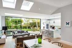 Open plan living - transforming this tired late Victorian semi-detached house in Wimbledon into a contemporary family home. At ground floor level an extension to the rear and the side created the space for a new kitchen, downstairs and accessible WC. Open Plan Kitchen Dining Living, Open Plan Kitchen Diner, Open Plan Living, Open Plan House, Semi Open Kitchen, Kitchen Diner Lounge, Open Living Area, House Extension Plans, House Extension Design