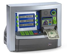 Discovery ATM  The Discovery ATM Machine is the ultimate at-home money management machine for children of all ages. Just like the neighborhood bank, savers can keep cash locked away in the Discovery ATM and save up for a rainy day. Cash is protected by a personal identification number, and a balance check is available at any time. So, sock it away in this piggy bank for a new generation!