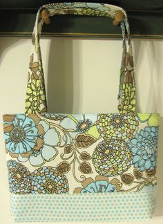http://www.etsy.com/listing/98725378/floral-and-polka-dot-easy-bag?ref=v1_other_2