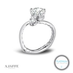 """A. Jaffe platinum and diamond asymmetrical engagement ring. The inside of the signature A. JAFFE """"Euro shank"""" features a quilted texture, which symbolizes the comfort and love shared in a relationship. This texture also provides additional comfort to the wearer. Voted a Fall 2014 platinum fan favorite as seen on Martha Stewart Weddings."""