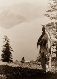 A Klamath Chief Stands On A Hill Above Crater Lake, Oregon, 1923