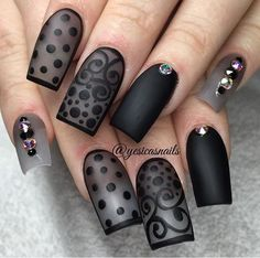 Black acrylic nails with lace designs using matte