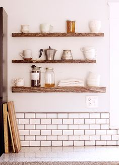 These shelves are made with wood from my parent's property in rural Tennessee. We use it to store our coffee and keep a few other kitchen items handy. We get our honey from an incredible local Tennessee farmer named Todd. The mugs and bowls are made by my dear friends Meridith Holder and Lily Glass.