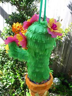 Cactus pinata with tissue paper flowers. For a Mexican party... or for someone who just loves cute cactus plants!