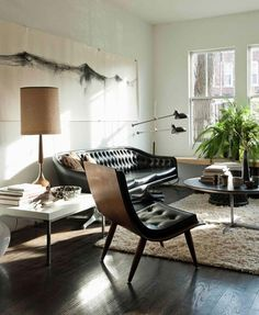 In more masculine rooms, there tends to be neutral and darker color palettes. Furniture lines are clean, streamlined and are often more modern. You'll tend to find different finishes of wood, varying from dark to light with chrome accents and modern art on the walls. And you can bet on finding a leather piece in there somewhere!
