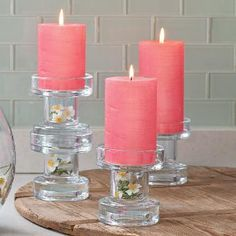 Versatile, modern glass holder does it all! Tealight well on one side or invery to hold pillars and Escential jars. Can also be stacked. Pink pillar candles, white candles