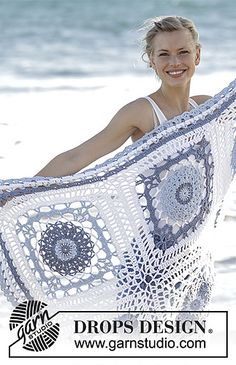 Crochet blanket with squares and lace pattern in DROPS Paris.